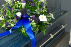 Casket with beautiful funeral flower arrangement