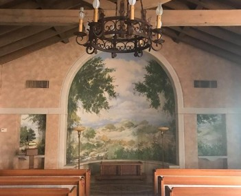 Custom mural and original architecture inside the chapel.