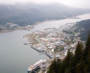 Aerial view of Downtown Juneau, the cruise ship port, and Douglas Island from the Mount Roberts Tramway.