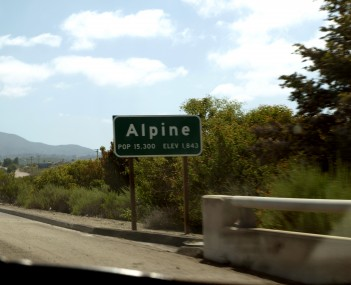 Alpine's town sign at its western border, as seen from I-8