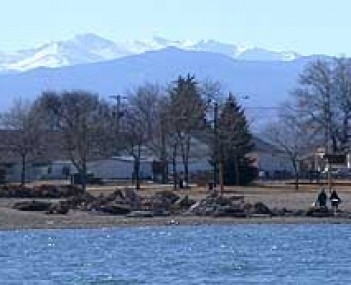 The snow-capped peaks of the Front Range, visible from the bike path on Windsor Lake, just north of Main Street