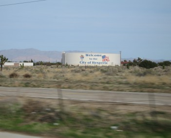 A water storage tank with the city of Hesperia logo and Welcome sign