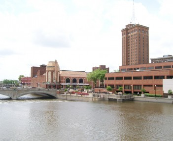 The Fox River and Galena Boulevard dam, Paramount Theatre, Aurora Riverwalk, Civic Center, and Leland Tower