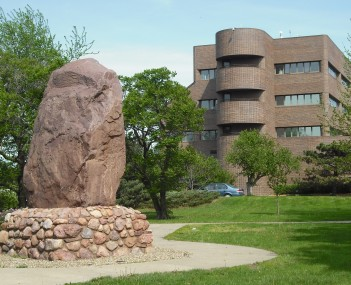 Lawrence City Hall with the Shunganunga Boulder in Robinson Park at the north end of Massachusetts Street