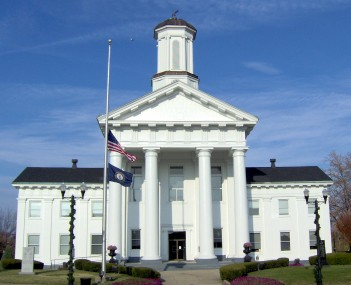 Madison County courthouse, Richmond, with flags at half-staff in honor of Veterans Day .