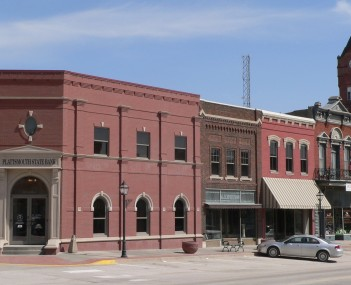 The Plattsmouth Main Street Historic District is listed in the National Register of Historic Places.  At upper right is the clock tower of the Cass County Courthouse.