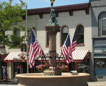The Bear Fountain sits in the center of Geneseo village's main street. In this picture, it is decorated with flags for Memorial Day.